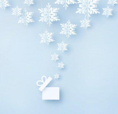 Kartka świąteczna z płatkami śniegu papieru. Otwórz pudełko i latające płatki śniegu na niebieskim tle. Koncepcja wektor Boże Narodzenie, nowy rok lub zima.