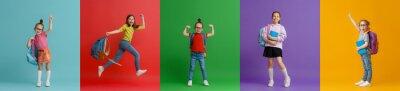 Naklejka Kids with backpacks on colorful background