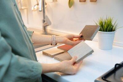 kitchen interior design - woman selecting furniture material texture