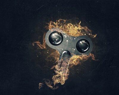 Klucz znak w płomieniach ognia. Różne środki przekazu