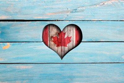 Naklejka Kocham Kanady. Serce i flagi na niebieskim drewnianym pokładzie