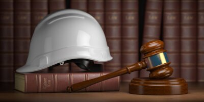 Naklejka Labor law concept. Gavel  with concstruction hard hat and books.