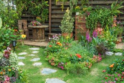 Naklejka Landscaped backyard flower garden of residential house
