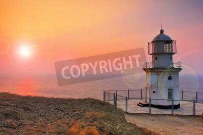 Naklejka Lighthouse on the coast at dawn