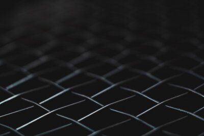 macro shot of black net tennis racket for background