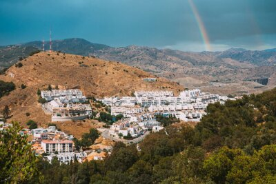 Naklejka Malaga, Spain. Cityscape aerial view of residential district. residential houses. real estate. Altered Sky With Rainbow