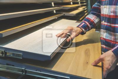 man choosing kitchen countertop materials at interior design shop
