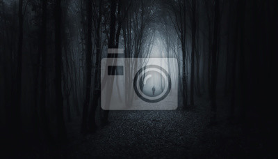 man in forest at night halloween scene