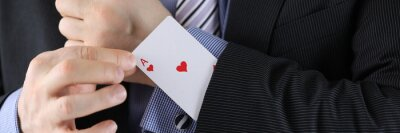Naklejka Man in suit puts ace of chirv card into sleeve of his jacket. Decisive secret business idea concept.