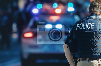 Naklejka Manhattan 2019. Behind the police with gun belt