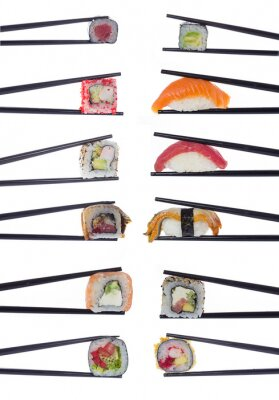 Naklejka Many sushi rolls in chopsticks isolated on white background