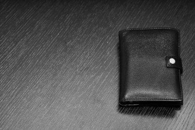 men's black wallet money in cash wooden black vintage background