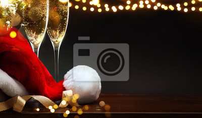 merry Christmas and happy New year; champagne and Santa hat