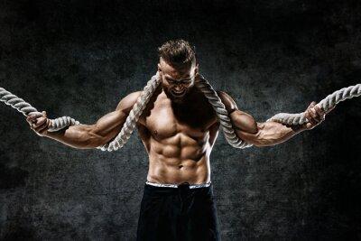 Naklejka Mięśni człowieka z liny. Zdjęcie człowieka z doskonałym ciałem po treningu. Styl mody