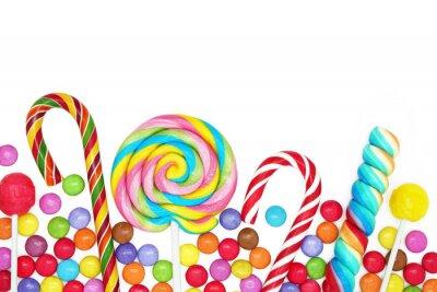 Naklejka Mieszane kolorowe cukierki na białym tle