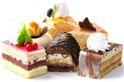 Naklejka Mieszanka różnych mini ciastka ze śmietaną, czekoladą i jagód