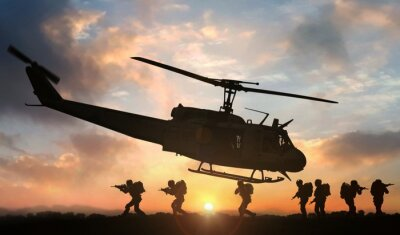Naklejka Military special force assault team helicopter drops during sunset