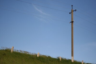 minimalist photo of power lines in the field