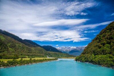 Naklejka Mleczna niebieski lodowaty wody Whataroa River w Nowej Zelandii