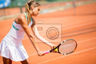 Naklejka Młoda kobieta, grać w tenisa