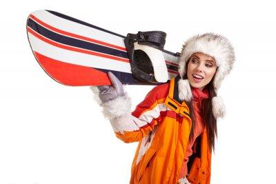 Naklejka Młoda kobieta stojąca z snowboard izolowane na białym