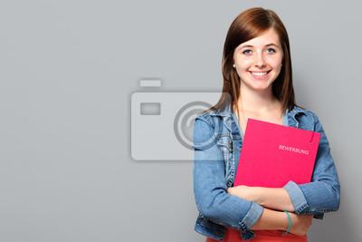 Naklejka Młoda kobieta z portfela aplikacji