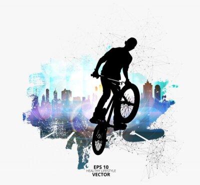 Naklejka Młoda męska skoczek rowerowy. Zdrowy tryb życia.