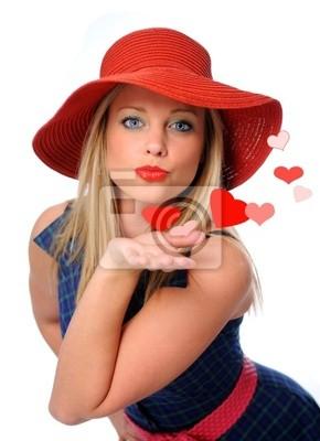 Młoda piękna kobieta dmuchanie pocałował jej walentynki