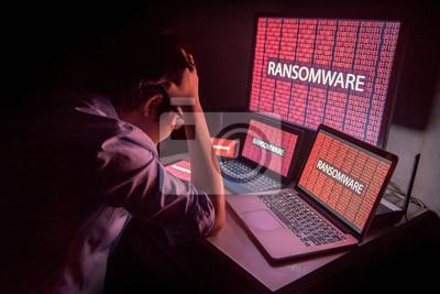 Naklejka Młody Azjata sfrustrowany atakiem cybernetycznym ransomware