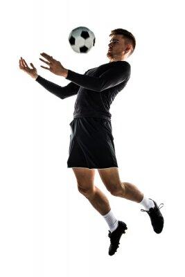 Naklejka Młody blondyn playing football