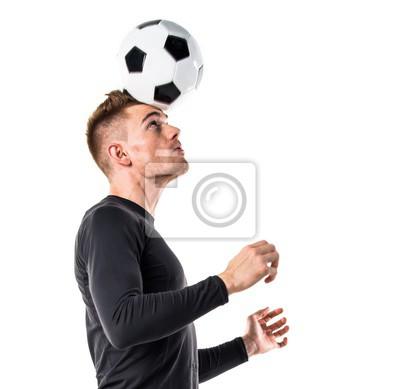 Młody blondyn playing football