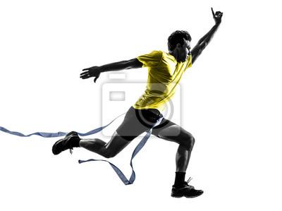 Młody człowiek biegacz sprinter mecie zwycięzca sylwetkę