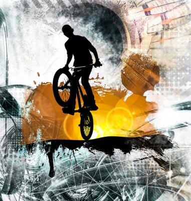 Naklejka Młody męski skoczek rowerowy. Zdrowy tryb życia
