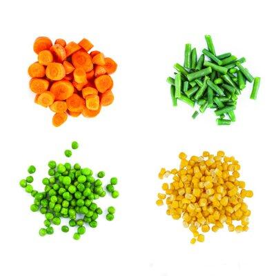 Naklejka Mnóstwo różnych ciętych warzyw samodzielnie na białym tle. Widok z góry.