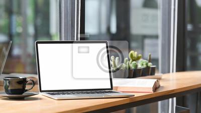 Naklejka Mockup laptop computer, coffee, book on cafe table.