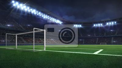modern football stadium illuminated by spotlights and empty green grass