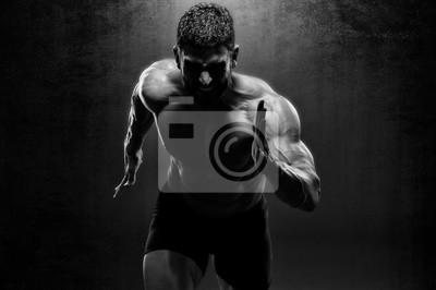 Naklejka Muscular Men in Running Motion. Handsome Male Athlete Sprinting