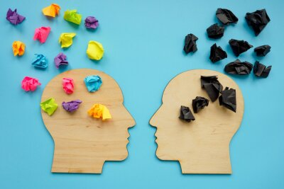 Naklejka Negative and positive thinking concept. Head shapes with color paper balls.