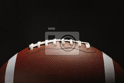 Naklejka New American football ball on dark background