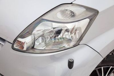 Naklejka Novosibirsk, Russia - 02.17.2020: Used silver Toyota Passo with an engine of 1.3 liters front headlight view on the car snow parking after preparing for sale