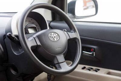 Naklejka Novosibirsk, Russia - 02.17.2020: View to the beige interior of Toyota Passo with dashboard, media system, front seats, steering and shiftgear after cleaning before sale on parking