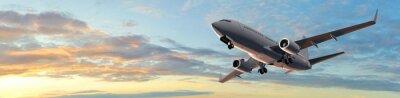 Naklejka Nowoczesny samolot pasażerski lot w zachód słońca panoramy