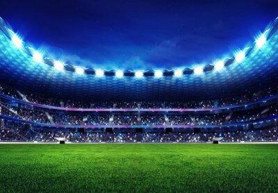 nowoczesny stadion piłkarski z kibicami na trybunach