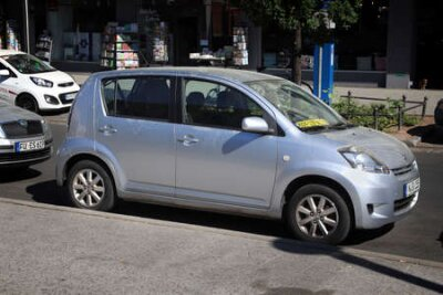Naklejka NUREMBERG, GERMANY - MAY 7, 2018: Daihatsu Sirion Japanese economy car parked in Germany. There were 45.8 million cars registered in Germany (as of 2017).