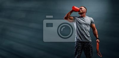 Naklejka Nutritional Supplement. Muscular Men Drinks Protein, Energy Drink After Workout