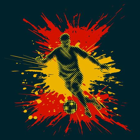 Odosobniona postać gracz piłki nożnej z półtonowym skutkiem. Jasne plamy tworzące hiszpańską flagę.