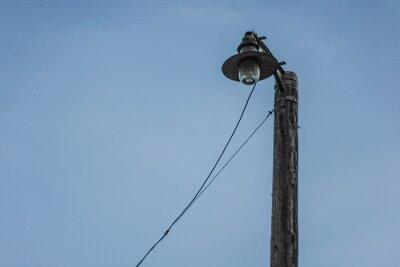 old power pole against sky