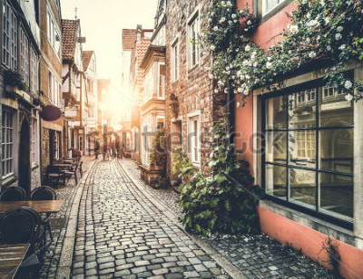Naklejka Old town in Europe at sunset with retro vintage Instagram style filter effect