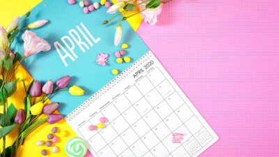 Naklejka On-trend 2020 calendar page for the month of April modern flat lay with seasonal food, candy and colorful decorations in popular pastel colors. Copy space. One of a series for 12 months of the year.