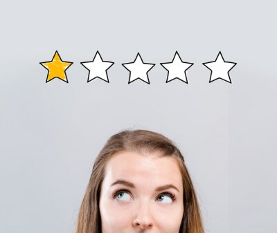 Naklejka One star rating with young woman looking upwards